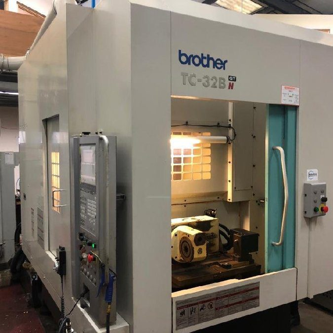 Used BROTHER TC 32 BN QT machining center with pallet changer